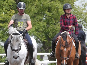 German rider Philipp Weishaupt and Canadian Olympic hopeful Kara Chad ride in the sand ring Tuesday July 5, 2016 prior to the Wednesday start of the Spruce Meadows North American. (Ted Rhodes/Postmedia)