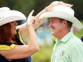 Champions Tour player Jeff Maggert, from Sea Pines, SC, was awarded a white hat by Councillor Diane Colley-Urquhart after posting a final score of -16 to clinch the Shaw Charity Classic at the Canyon Meadows Golf and Country Club on August 9, 2015.