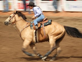Mary Burger of Pauls Valley, OK, during the barrel racing event at the Calgary Stampede rodeo on Sunday, July 10, 2016. AL CHAREST/POSTMEDIA
