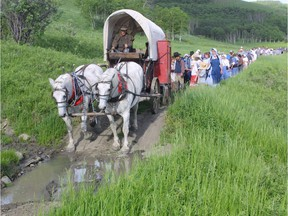 A file photo of a reenactment of the Mormon Trail through the Porcupine Hills of Southern Alberta. PUBLISHED JUNE 30, 2002