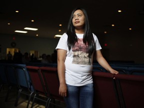 Reylene Punzalan, a migrant worker from the Philippines who is working in seafood processing in New Brunswick, poses for a photo at the Shediac Bay Community Church on Sunday August 28, 2016. Thanks to a rule that limited many temporary foreign workers to four years in Canada starting in April 2015, Canada's undocumented population may have grown by more than 100,000 people.