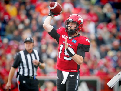 Calgary Stampeders quarterback Bo Levi Mitchell looks to throw the ball during a game against the Hamilton Tiger-Cats in CFL football in Calgary, Alta., on Sunday, August 28, 2016. AL CHAREST/POSTMEDIA