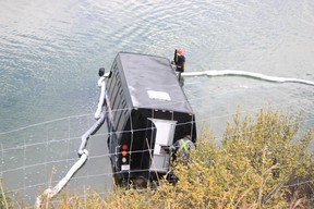 One person died after a tour bus drove through the parking area  Castle Mountain Lookout, just off of the westbound lane of the Trans-Canada Highway  in Banff National Park, and landed in the Bow River on the morning of Wednesday, September, 21, 2016. Amanda Symynuk/ Crag & Canyon/ Postmedia Network