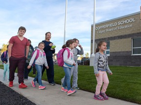 Students head to Copperfield School on Sept. 6. So far, 15 new facilities have opened this school year, with three more on the way.
