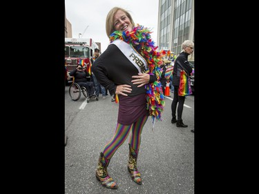 Premier Rachel Notley strikes a pose before walking in the Calgary Pride Parade in the city's downtown core on Sunday, Sept. 4, 2016. About 60,000 people were expected to watch the annual parade, as more than 125 entries took part. Lyle Aspinall/Postmedia Network