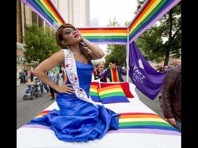 Karla Montecarlo rides with a Hyatt Regency float in the Calgary Pride Parade in the city's downtown core on Sunday, Sept. 4, 2016. About 60,000 people were expected to watch the annual parade, as more than 125 entries took part. Lyle Aspinall/Postmedia Network