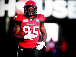 Calgary Stampeders Ja'gared Davis runs onto the field during player introductions before facing the BC Lions in CFL football in Calgary, Alta., on Friday, July 29, 2016. AL CHAREST/POSTMEDIA