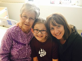 80-year-old Dementia patient Ann Derwent at the Peter Lougheed Centre with her granddaughter Olivia and daughter Darilyn Fortuna last May. Family Handout/Postmedia