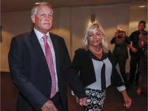 Federal Court Justice Robin Camp, left, and his wife Maryann arrive at a Canadian Judicial Council inquiry in Calgary.