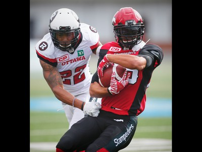 Calgary Stampeders Anthony Parker is tackled by Jeff Richards of the Ottawa Redblacks, who was called for unnecessary roughness on the play, during CFL football in Calgary, Alta., on Saturday, September 17, 2016.