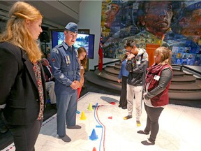 Army Cadet Warrant Officer 2nd Class Michael Batas speaks as he and a group walk on a floor map of Vimy Ridge during a launch event for the Spirit of Vimy program in Calgary, Alta on Thursday September 22, 2016. The education initiative was created by the Honourable Lois Mitchell and the Spirit of Vimy will foster greater awareness of, and appreciation of Canadian soldiers during the pivotol battle. Jim Wells/Postmedia