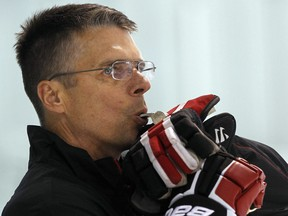 Flames assistant coach Dave Cameron, wshown here at the Ottawa Senators training camp in 2011, got his start in the 1990s coaching in Michigan.