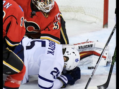 The Toronto Maple Leafs James van Riemsdyk goes down as Calgary Flames goaltender Chad Johnson stops the puck during the second period of NHL action at the Scotiabank Saddledome in Calgary on Wednesday November 30, 2016.