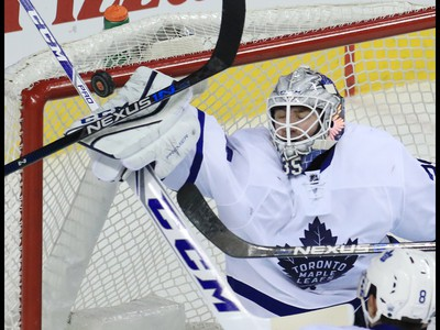 Toronto Maple Leafs goaltender Jhonas Enroth stops this close shot during the third period of NHL action at the Scotiabank Saddledome in Calgary on Wednesday November 30, 2016.  GAVIN YOUNG/POSTMEDIA
