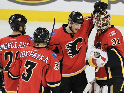 The Calgary Flames congratulate goaltender Chad Johnson on his 3-0 shut out against the Toronto Maple Leafs at the Scotiabank Saddledome in Calgary on Wednesday November 30, 2016.  GAVIN YOUNG/POSTMEDIA