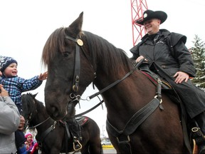 Bo Fornataro, 1, and his grandfather Russ Fornataro got a chance to meet Ranger the police horse during the Disaster Alley demonstration to kick off Emergency Preparedness Week at McMahon Stadium on May 4, 2014. Christina Ryan/Postmedia