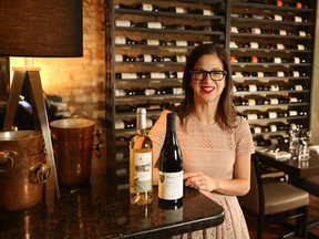 Blink Restaurant and Bar owner Leslie Echino, with bottles of the exclusive wine she's selling to raise money for Hospice Calgary.