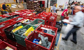 Volunteers at the Calgary Food Bank fill hampers at the warehouse.