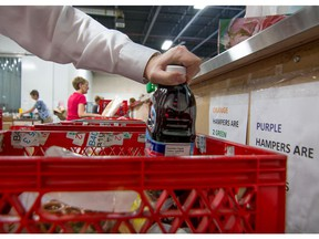 Volunteers at the Calgary Inter-Faith Food bank fill hampers at their warehouse in Calgary.