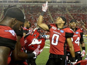 Calgary Stampeders Ciante Evans, right, celebrates his interception on the BC Lions with teammates during CFL action at McMahon Stadium in Calgary, Alta.. on Friday July 29, 2016. Leah Hennel/Postmedia