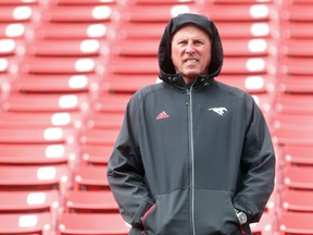 In his first season away from head coaching, Calgary Stampeders GM John Hufnagel watches from the stands during the team's rookie camp Friday May 27, 2016. The main camp opens Sunday. (Ted Rhodes/Postmedia) ORG XMIT: POS1605271333250792