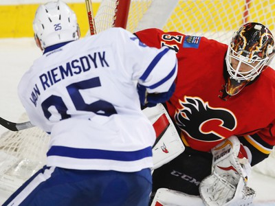 Calgary Flames Chad Johnson makes a save on a shot by James van Riemsdyk of the Toronto Maple Leafs during NHL hockey in Calgary, Alta., on Wednesday, November 30, 2016.