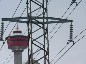 Photo shows the Calgary Tower framed behind power lines in downtown Calgary Jan 29/10. A bill is being proposed by the legislature may change how citizens are charged for their electricity. JIM WELLS/ QMI AGENCY ORG XMIT: p5powerlines300