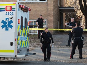 Police contain the scene of a suspicious death in the el Manor apartment building at 1819 - 17th Street S.W. on Tuesday, Nov. 22, 2016.