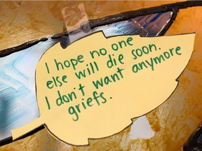 FILE PHOTO: Words from clients dealing with grief decorate the wall of the Sage Centre in Calgary on Wednesday November 23, 2016.