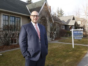 Shamon Kureshi, President and Managing Broker for Hope Street Real Estate Corp. poses in front of a rental property on 4 St SW in Calgary, Alta on Thursday November 24, 2016. The company says a record 37% of Calgary's available rental listings are currently sitting empty. Jim Wells//Postmedia