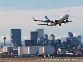 An WestJet Boeing 737 takes off from Calgary International Airport.