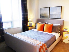The second bedroom in the Plan L show suite at Bridgeland Crossings II, by GableCraft Homes and Apex CityHomes.