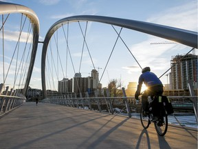 A cyclist cruises over St. Patrick's Bridge to East Village, which saw one of the most successful community engagement programs.