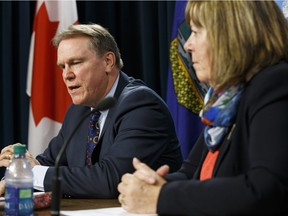 FILE PHOTO: Dave Mowat, president and CEO of ATB Financial, and Marg McCuaig-Boyd, Energy Minister, speak about Mowat's appointment as head of a royalty review advisory panel in this file photo.