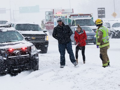 Emergency workers deal with a multi-car collision on Deerfoot Trail at Southland Drive on Sunday February 5, 2017. At least 10 cars were involved in several different accidents at the same location.