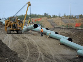 Midwest Construction workers assemble the Enbridge pipeline to Hardisty southeast of New Sarepta in this file photo from Monday Sept. 29, 2014.