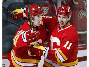 Calgary Flames left wing Matthew Tkachuk, left, celebrates his goal against the Philadelphia Flyers with teammate Mikael Backlund in Calgary on Wednesday, Feb. 15, 2017. (Jeff McIntosh/The Canadian Press)