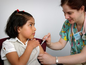 A girl receives an intramuscular vaccination from a nurse. Provided by: Judy Schmidt, CDC.