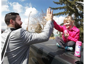 Calgary Flames player Deryk Engelland is greeted by young fan Faith Barber as the Flames were boarding the team bus in Calgary for the trip to Anaheim, Calif., on Tuesday April 11, 2017. Engelland wished the girl a happy fifth birthday and gave her a high five. The Flames play the Anaheim Ducks in the first round of the NHL Playoffs starting on Thursday. (Jim Wells)