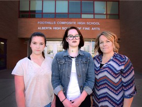Left, Marley Stasiuk (Grade 10), her sister Landry (Grade 12) and their mother Tanya in Okotoks, on April 11, 2017. The Stasiuk family has been in a battle with Foothills Composite High School over school fees they don't feel are legal under the Alberta School Act.