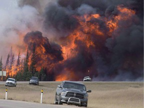 Fire rips through the forest 16 kilometres south of Fort McMurray, Alta., on highway 63 on May 7, 2016.