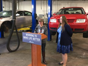 Kaylee Mannhardt, a graduate of the Motive Action Training Foundation, speaks at a government announcement Wednesday while Labour Minister Christina Gray looks on. The NDP government is raising the funding for skills training organizations such as Motive Action by $10 million over two years.