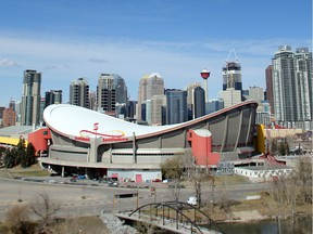 The Saddledome stands out against the Calgary skyline.
