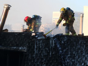 Fire crews battle the two-alarm blaze at 16th Street and 15th Avenue S.W. in Sunalta Monday.
