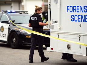 The Calgary police forensic unit on scene after an incident at 83 Panamount Common in NW Calgary, Alta., on June 10, 2017.