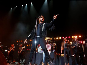 Usher performs at the Scotiabank Saddledome with The Roots on Saturday.