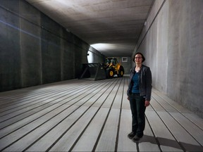 Philippa Wagner, green cart implementation leader, inside one of 18 massive composting rooms.