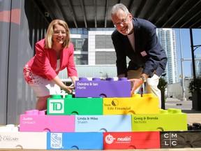 Calgary Sun, Calgary Herald  Deirdre and Ian Harris pose for a photo at a ceremony celebrating the couple's $1 million legacy gift to the Calgary Public Library.  Wednesday, July 26, 2017. Dean Pilling/Postmedia  Postmedia Calgary Dean Piling/Postmedia
