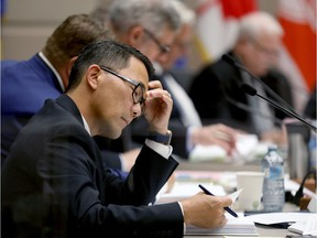 Postmedia Calgary  Ward 4 Councillor Sean Chu during council as the Calgary Bid Exploration Committee delivered its 5,400-page report to City Council Monday on Sunday July 23, 2017. DARREN MAKOWICHUK/Postmedia Network Darren Makowichuk, DARREN MAKOWICHUK/Postmedia
