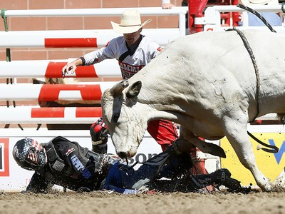 Tanner Byrne from Prince Albert, SK, riding Milky Chance has some problems during the bull riding event on day 7 of the 2017 Calgary Stampede rodeo on Thursday July 13, 2017. DARREN MAKOWICHUK/Postmedia Network